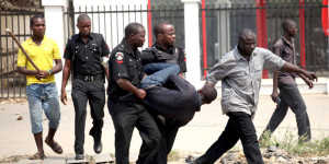 A man is arrested by the police for looting on the fourth day of a nationwide strike against the removal of the petrol subsidy in Lagos January 12, 2012. Tens of thousands of Nigerians have been protesting up and down Africa's most populous nation for four straight days in protest against the axing of the petrol subsidy, which more than doubled the price to around 150 naira ($0.93) per litre.  REUTERS/Akintunde Akinleye (NIGERIA - Tags: CIVIL UNREST POLITICS ENERGY)